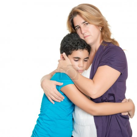 Sad mother hugging her son isolated on white
