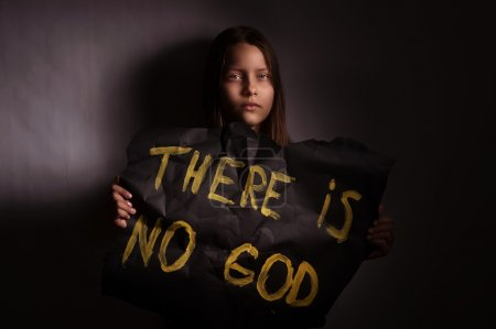 Atheist teen girl holding a banner with the inscription