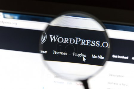 Photo for Close up of Wordpress website under a magnifying glass. WordPress is a free and open source blogging tool. - Royalty Free Image
