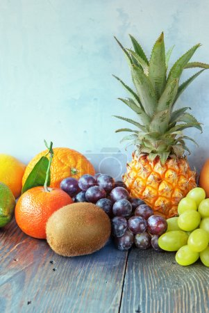 Photo for Healthy fruit background Different fruits on wooden table - Royalty Free Image