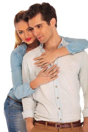 attractive couple posing in studio