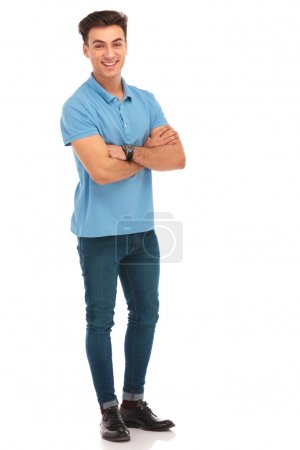 Photo for Happy hipster in blue shirt posing with arms crossed in isolated studio background while looking at the camera - Royalty Free Image