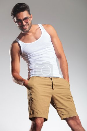 Smiling man  standing with hands in his pockets