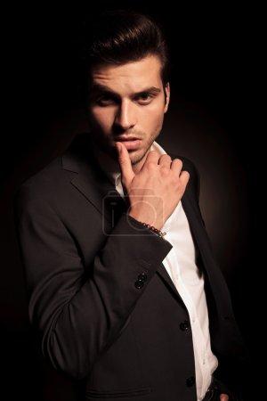 sexy provocative pose of a young fashion man