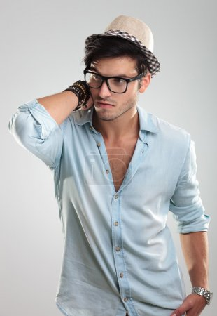 Attractive man wearing glasses and hat