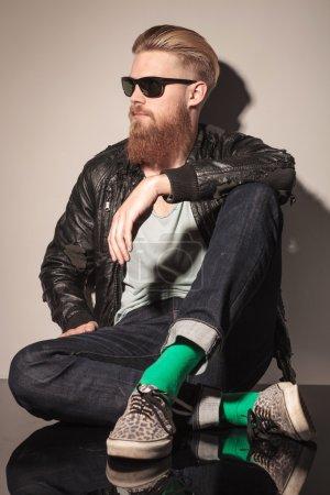 Fashion man with long red beard sitting