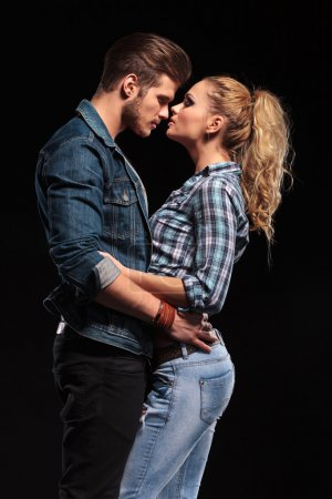 attractive young couple holding each other