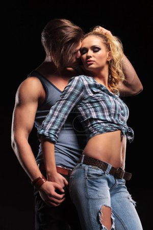 Young sexy man pulling his girlfriend hair