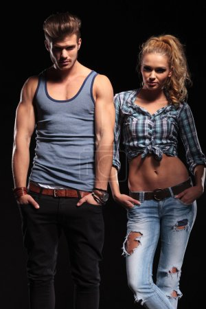 Hot couple posing on studio background