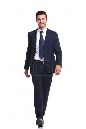 Happy business man walking on white studio background