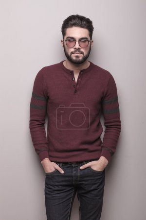 young man wearing sunglasses and a burgundy sweater