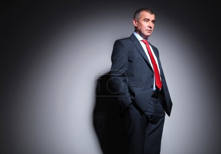 middle aged business man looking away from the camera