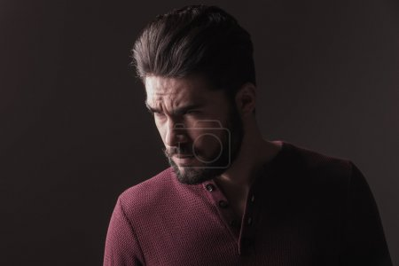 casual young man looking angry away from the camera