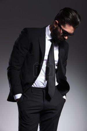 Elegant business man looking down