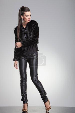 fashion woman posing on grey studio backgroud