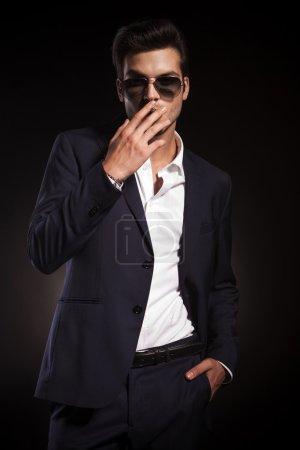 Elegant business man smoking a cigarette