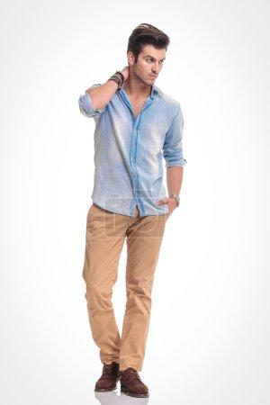 Attractive fashion man walking on studio background