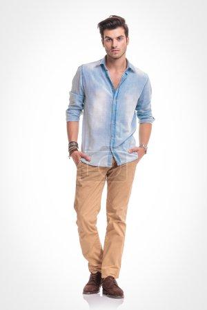 fashion man standing on studio background