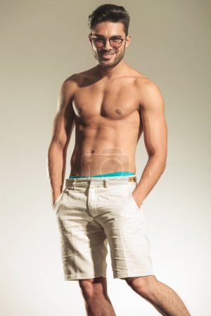 Shirtless sexy man posing with his hands in pockets