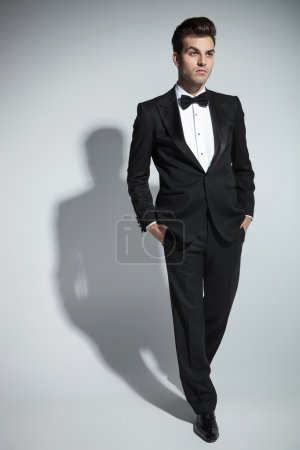 Handsome young business man walking