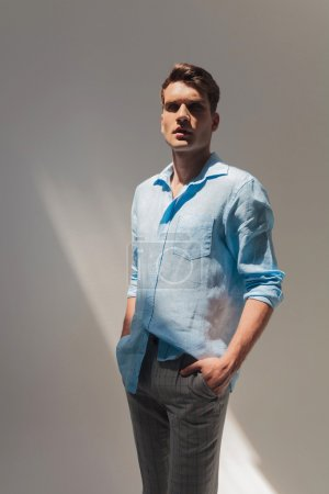 Photo for Picture of a handsome casual man standing with his hand in pockets - Royalty Free Image
