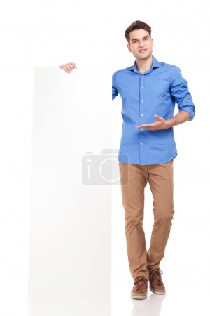 young fashion man presenting a white board