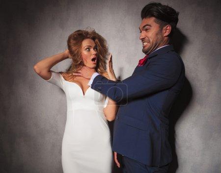 elegant man is playing of choking his lover