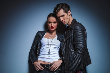 Couple in leather clothes posing in studio