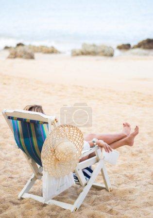 Young woman relaxing on a beautiful beach.