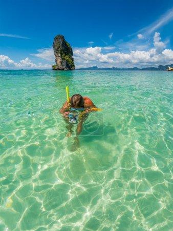 Beautiful woman snorkelling in Krabi Thailand