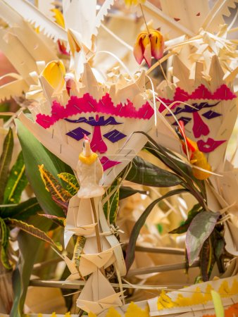 balinese offerings to gods in Bali with flowers and aromatic sti