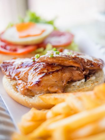 Photo for Yummy homemade chicken burger with fries - Royalty Free Image