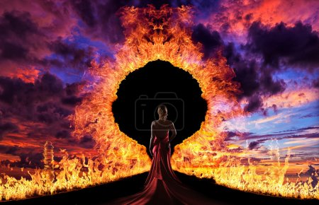 Photo for Woman at hell's door dramatic background - Royalty Free Image