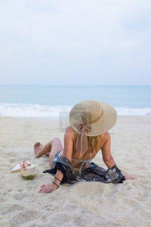Classy woman on the beach