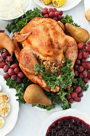 Photo for Whole homemade Thanksgiving Turkey with side dishes shot from above. - Royalty Free Image
