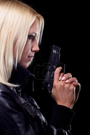 Beautiful girl with gun isolated on black background