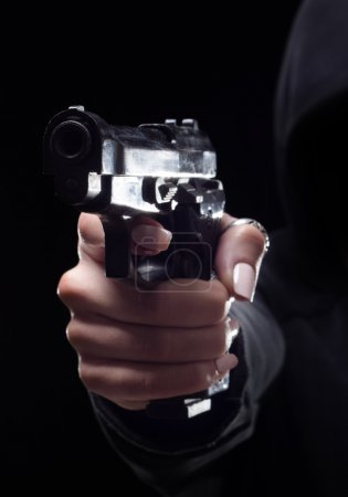 Female criminal shooting with gun on the street