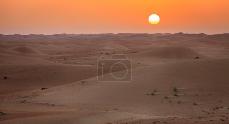 Photo for Sun rising over dunes of Dubai Desert Conservation Reserve, UAE - Royalty Free Image