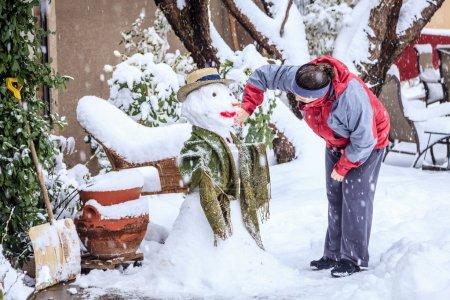 Woman is making snowman