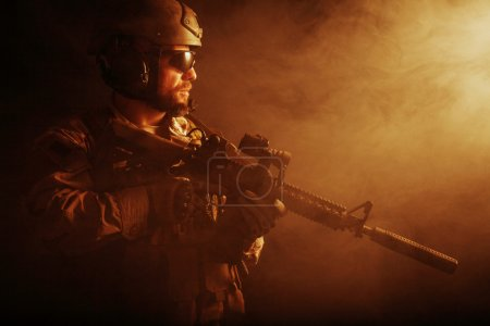 Bearded special forces soldier on dark background...