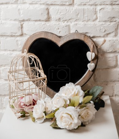 Photo for The frame as a heart with flowers on the white wall backgrounds - Royalty Free Image