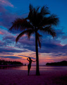 woman with palm trees on beach