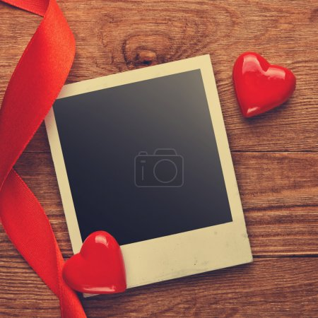 Blank instant photo and hearts