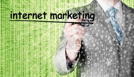 Businessman writing internet marketing