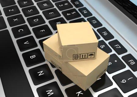Photo pour Concept d'entreprise de technologie, expédition, boîtes d'emballage en carton sur ordinateur portable - image libre de droit