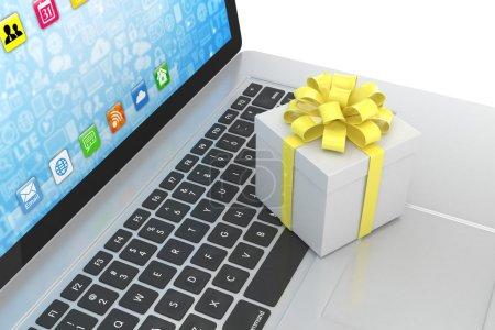 Gift box on laptop keyboard