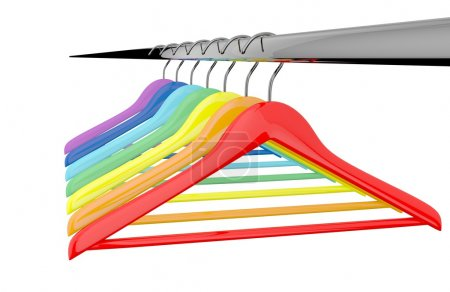 Photo for Row of color rainbow coat hangers on metal shiny clothes rail isolated on white background - Royalty Free Image