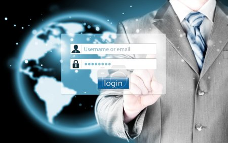 Businessman typing login and password