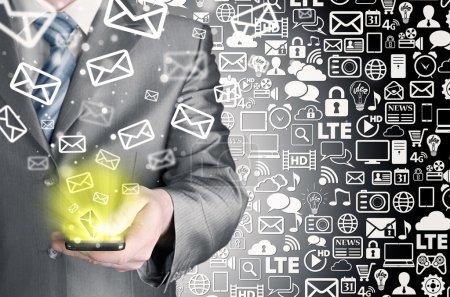 Businessman sending emails