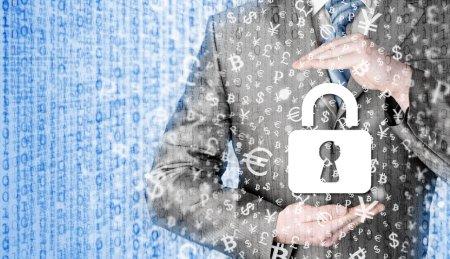 Businessman holding security lock